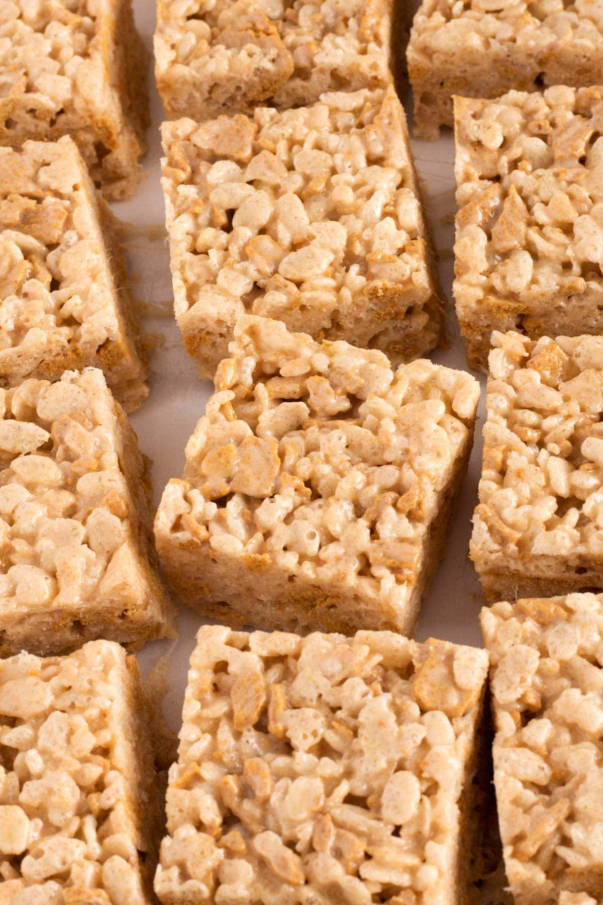 Square golden graham treats arranged on counter.
