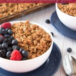 Bowls of granola and fresh berries with text overlay.