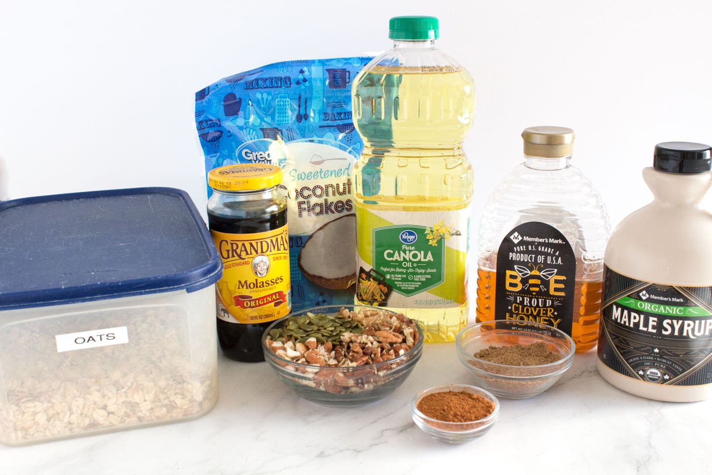 Ingredients for healthy homemade granola recipe with honey and maple syrup.