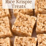 Rice krispie treats cut in squares on counter with text overlay.