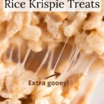 Very close view of gooey rice krispie treat with text overlay.