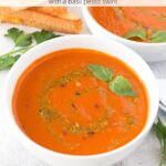 Roasted tomato soup in bowls with grilled cheese and graphic overlay.
