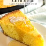 Honey being poured on slice of cornbread.