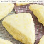Lemon scones on cooling rack with purple towel underneath and text overlay on top.
