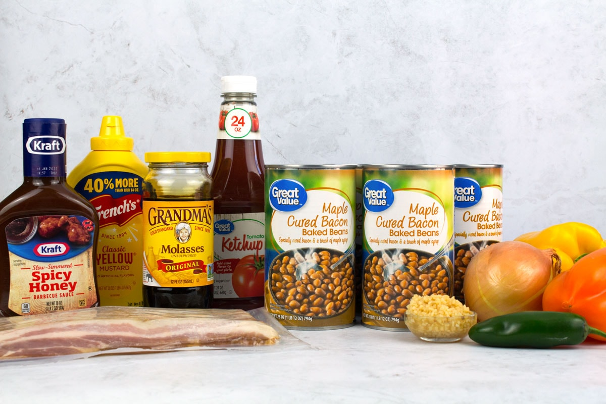 Easy Baked Beans Ingredients including canned beans, bacon, peppers, onions, garlic, and condiments.