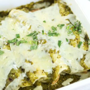Homemade Green Enchiladas with Honey Lime Chicken covered with melted cheese.