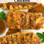 Overhead of grilled chicken breasts with sauce and parsley.