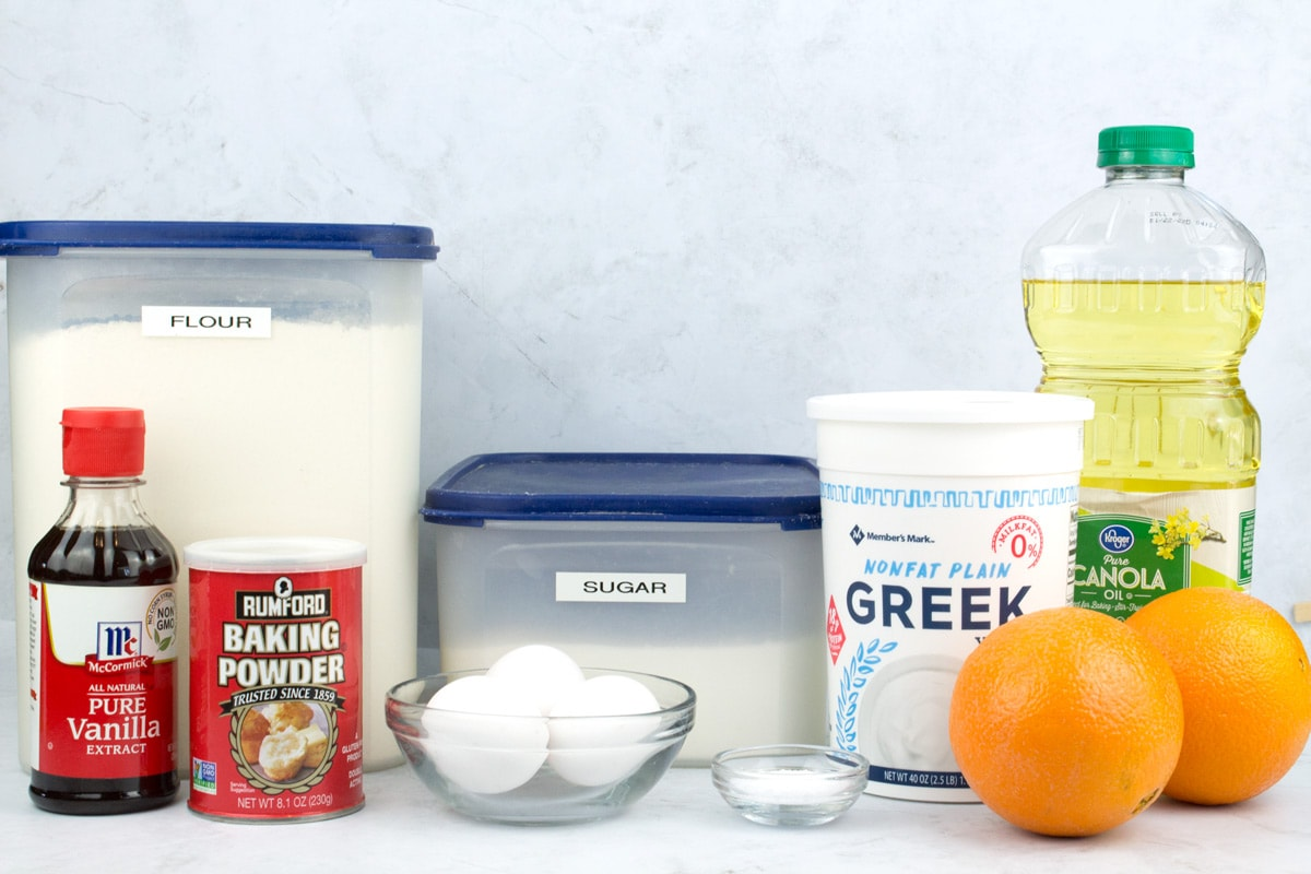 Ingredients for yogurt and oil loaf cake on counter.