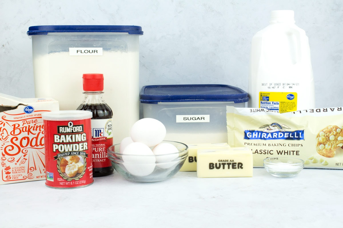 Ingredients for white chocolate bundt cake batter on a countertop.
