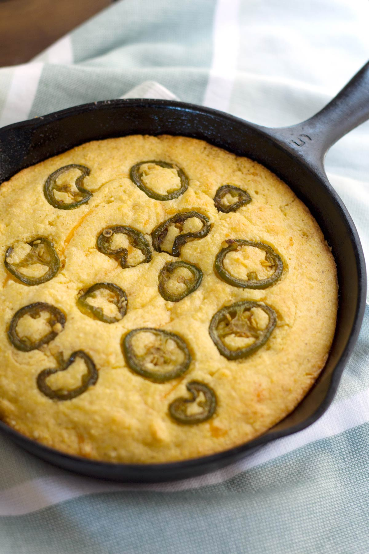 Cornbread after baking with jalapenos arranged on the top.