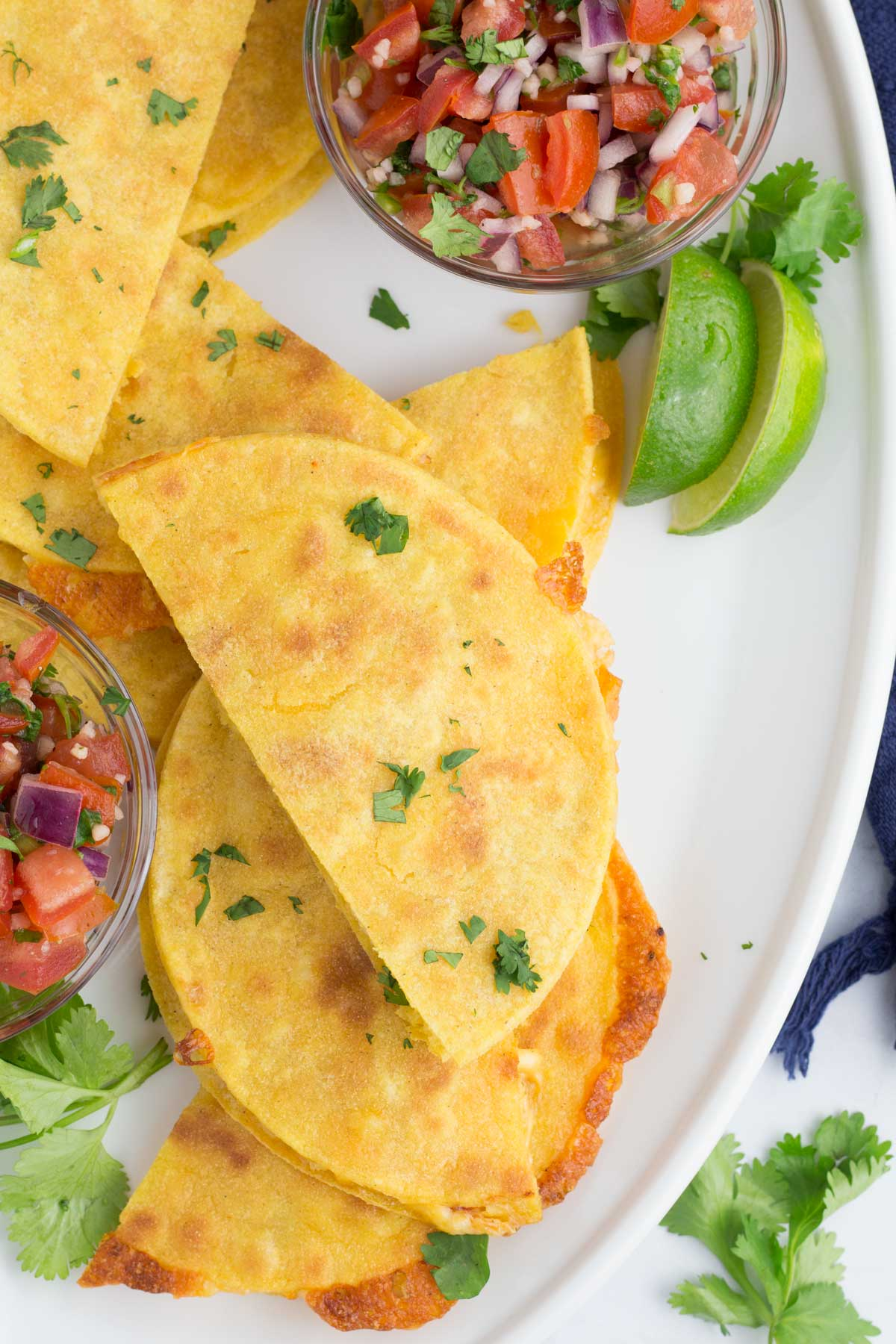 Overhead view of corn tortilla quesadillas on a serving tray.