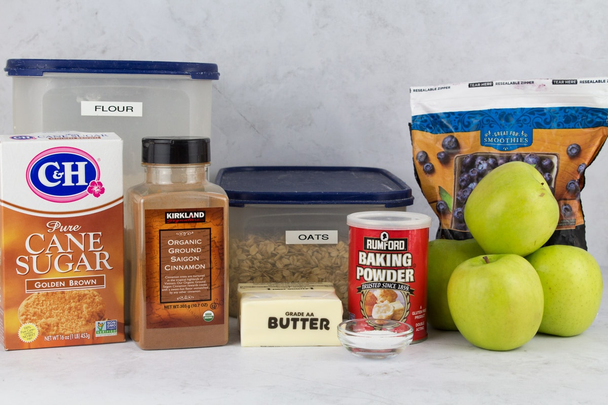 Ingredients for apple berry crisp on counter.
