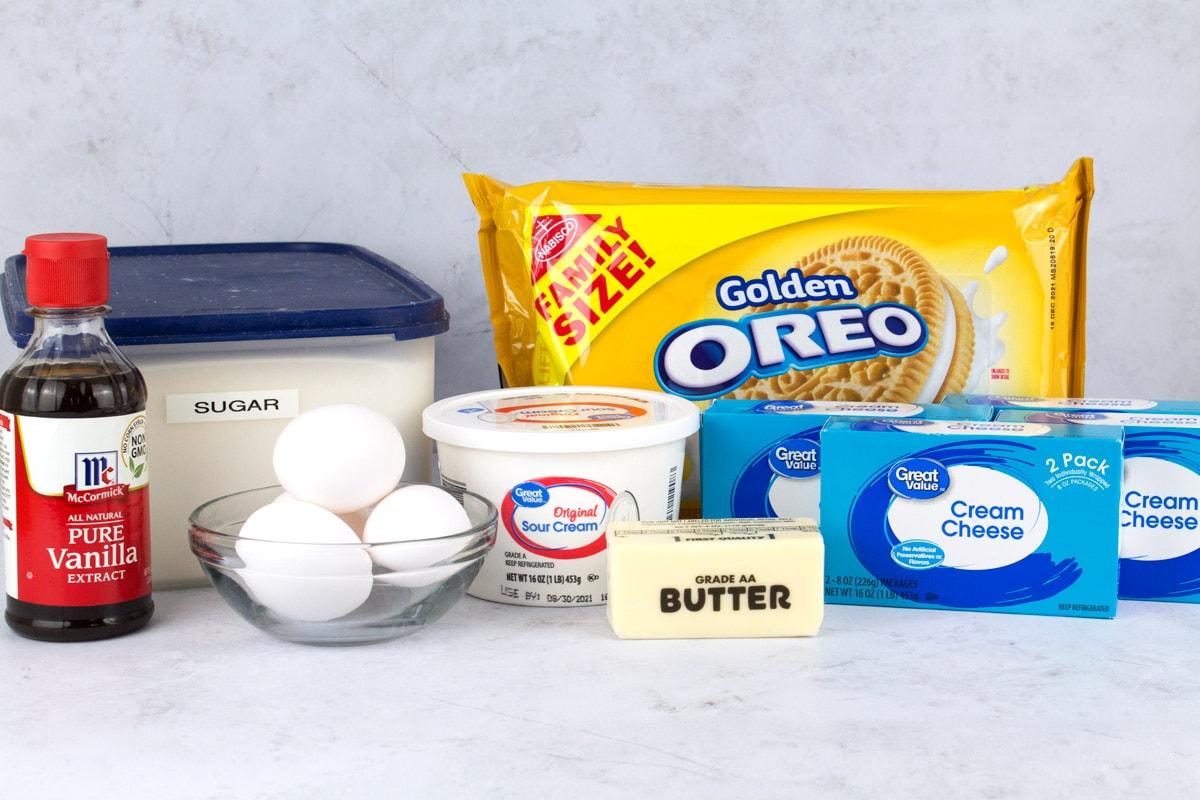 Ingredients for white Oreo cheesecake on counter.