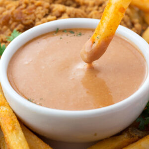 Fry dipping into bowl of Red Robin Campfire Sauce copycat recipe.