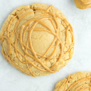 Peanut butter drizzled on cookie.
