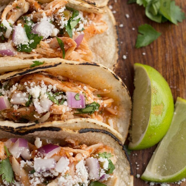 Corn tortillas filled with easy tinga sauce and chicken.