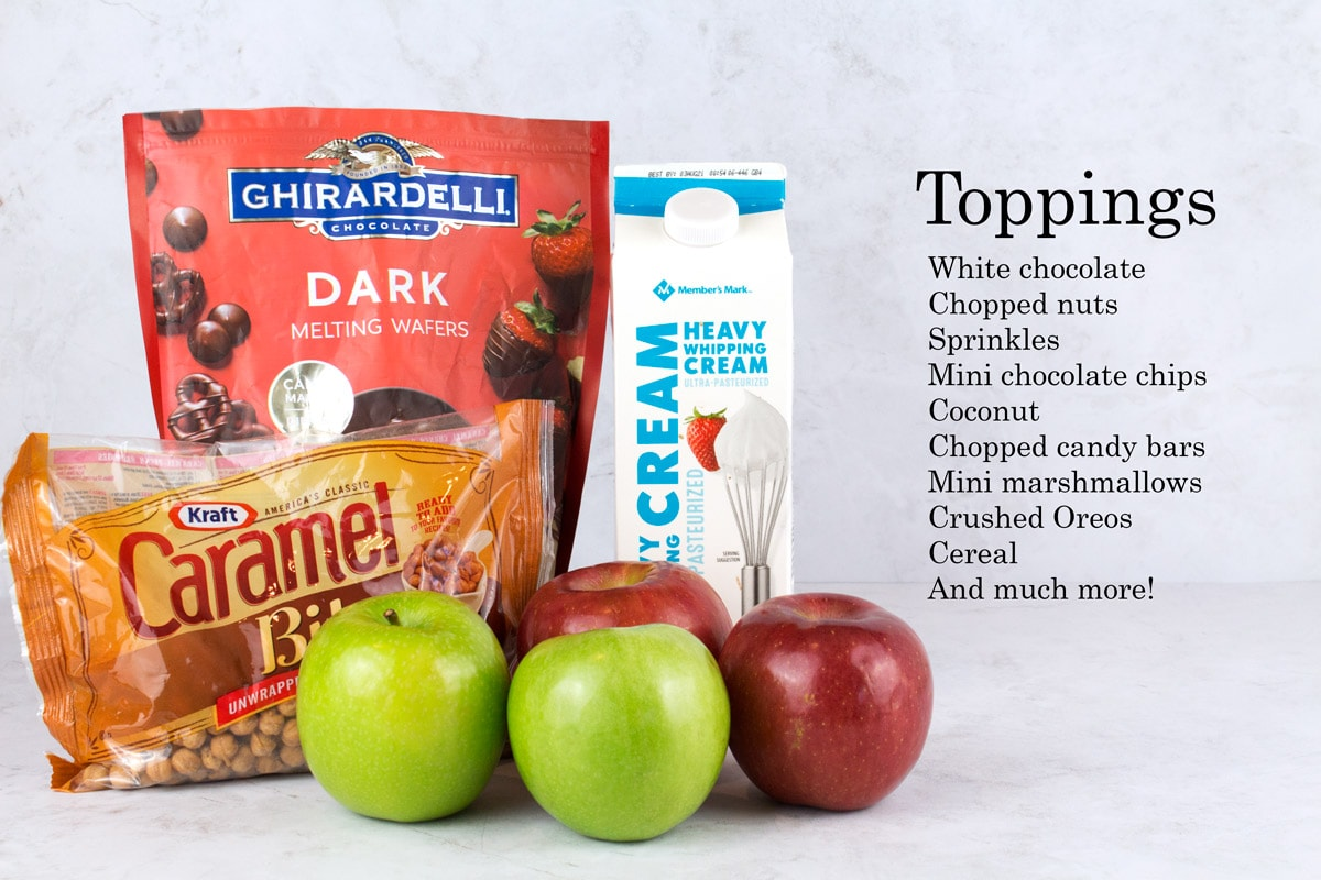 Ingredients for caramel apple slices recipe on counter with topping ideas typed on the side.