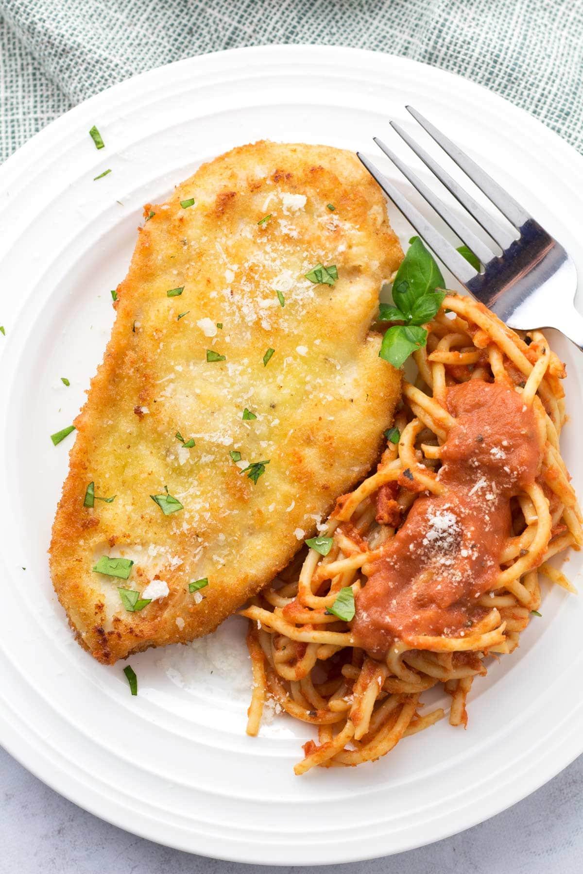 Plate of Cheesecake Factory Romano Chicken and spaghetti.