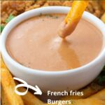 Fry dipping in bowl of Red Robin onion ring sauce with text overlay.