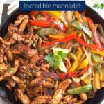 Chicken fajitas with peppers and onions in a cast iron skillet with graphic overlay.