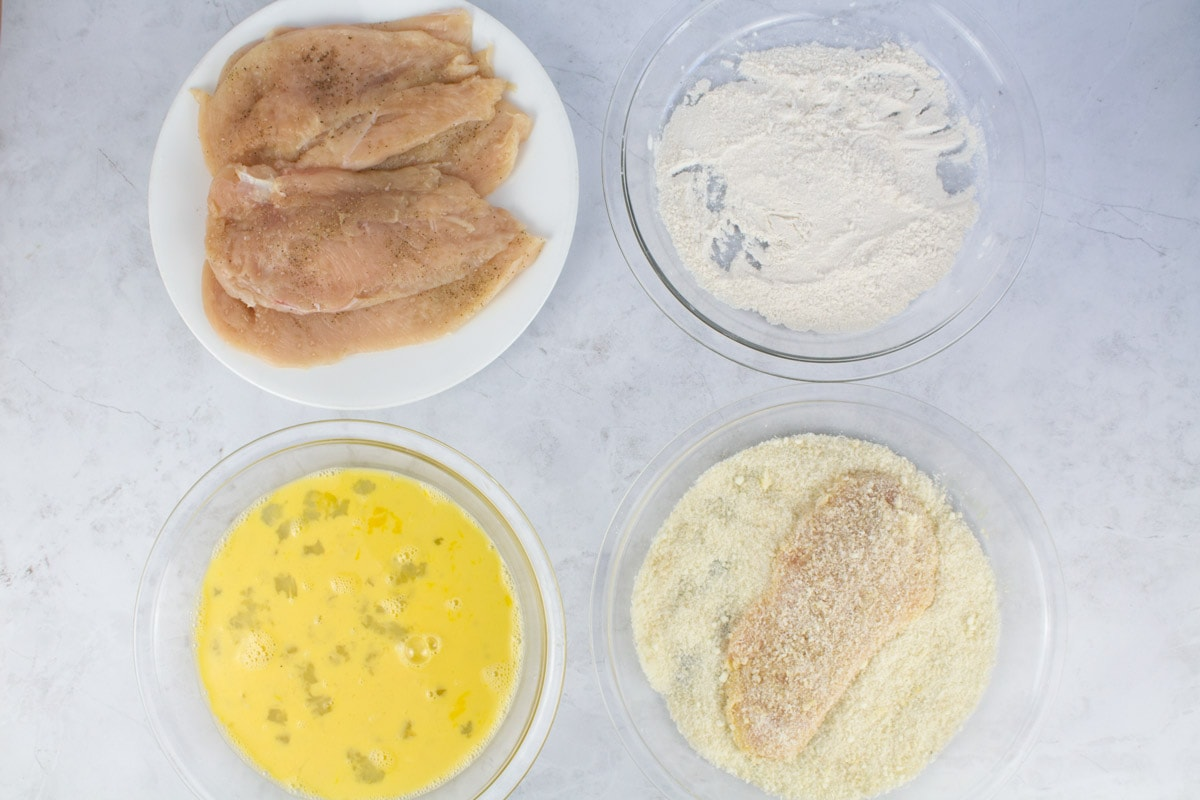 Breading of chicken romano step-by-step process.